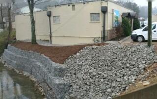 Gabion stone retaining wall at Mojo Burrito | Higher Ground of Chattanooga