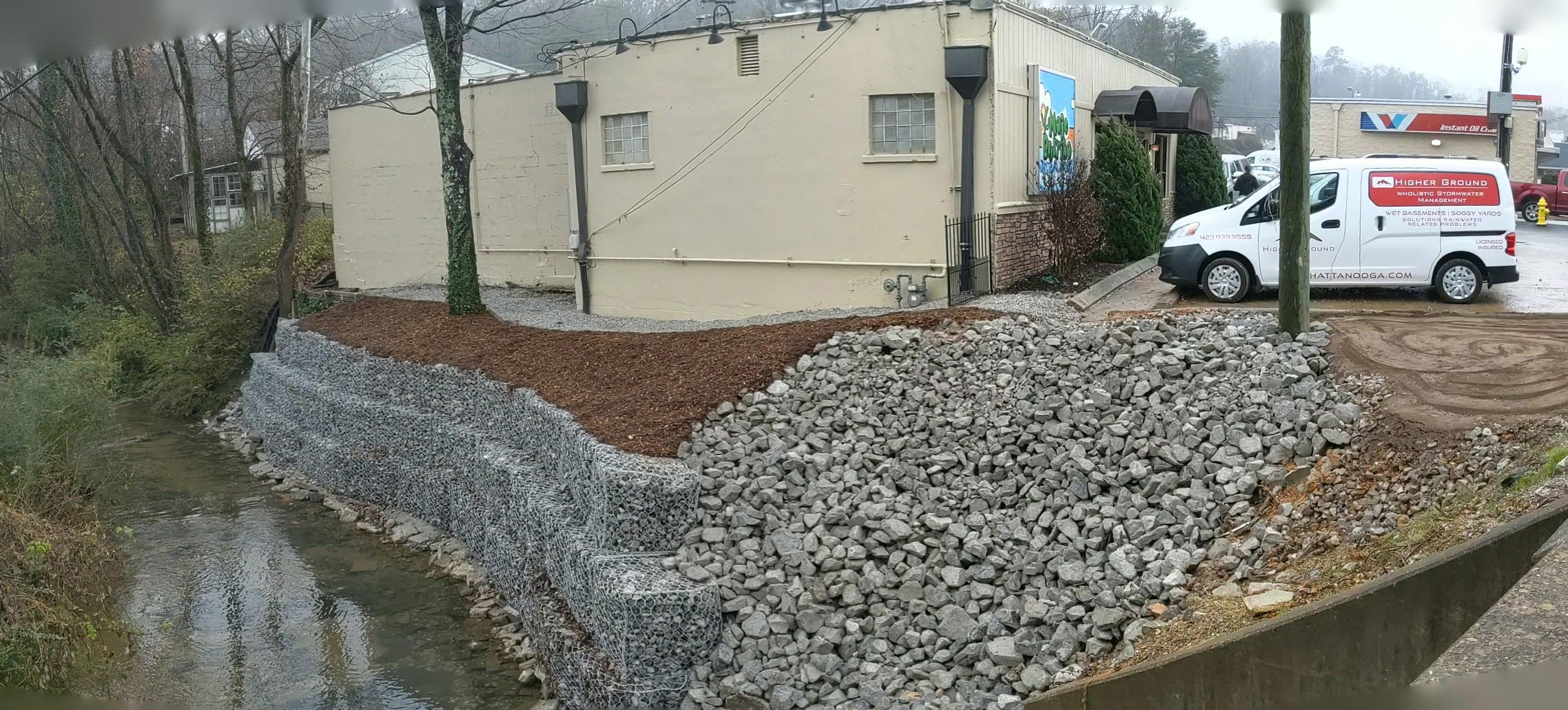 Gabion stone retaining wall at Mojo Burrito | Higher Ground of Chattanooga